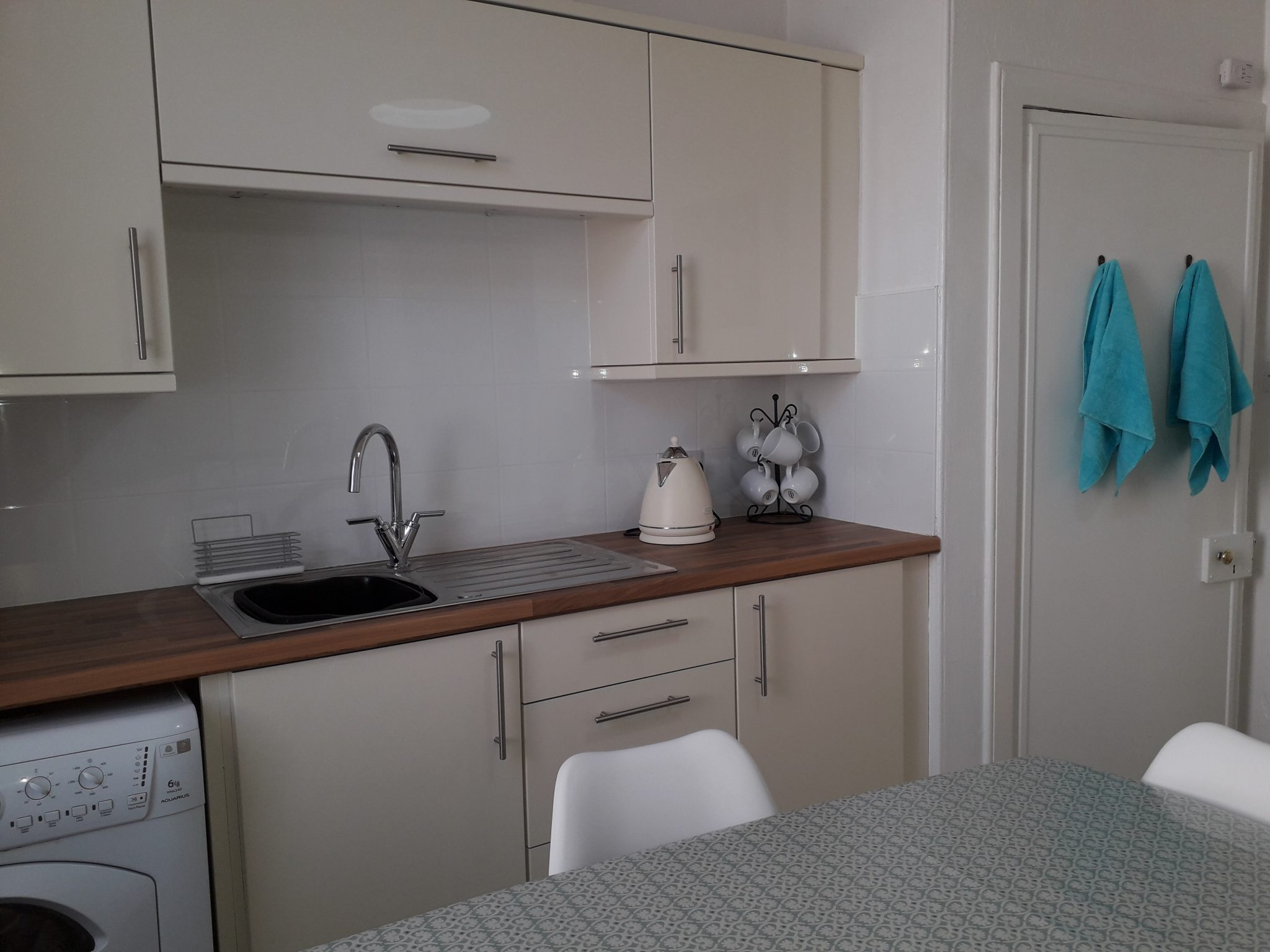 Kitchen with sink,units, table and chairs