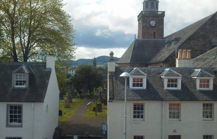 The Old High Church behind lovely old two storey houses