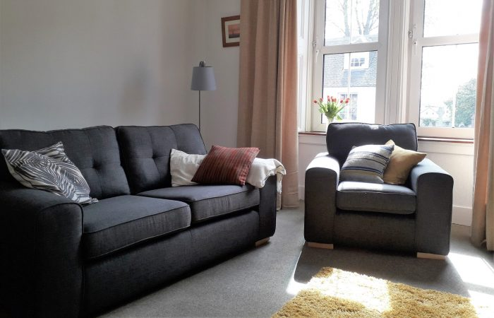 Bright living room with comfortable seating at 98 Church Street Inverness self catering apartment