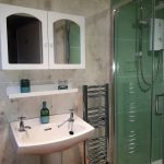 Shower, wash basin, towel rail and mirrored cabinet